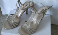 Gold size 8 sandals and matching evening purse....never worn or used.....call 604 491 8828
