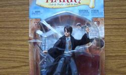 Dueling Club Harry Potter ( 2002 ) $20. Masters of the Universe - He Man ( 2001 ) $25. Both figures are still in the original packaging and have never been opened.