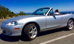 Make Mazda Model MX-5 Miata Year 2001 Colour Silver kms 85000 Trans Manual Yes, it's true. Only 85,000 KM (53,000 miles) on this 2001 Mazda Miata MX-5 with tan leather interior, tan soft top, tan rear tonneau cover, 6-speed manual transmission, Bose