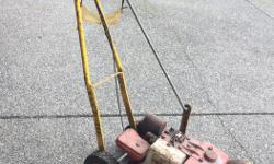 Old one but a good one, has not been started for a couple of years. 2 H.P. Briggs & Stratton motor.