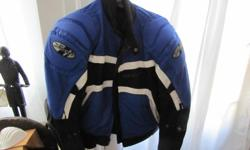 blue/black/white, reflective strips zip out liner venting in front and arms great jacket