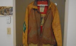 Men's Avirex jacket worth $ 1000. retail. Wears medium to large. Has zipper and button closure. Mustard in colour. 2 front pockets and one inside pocket. Heavy leather. First Nations (Native) figure embroider on back of jacket - really quite special. Is