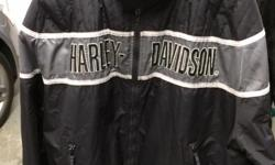 This Men's Harley Davidson Nylon Jacket is a size XL. It has been worn for a few season's but is still in great condition. Perfect for a warm day! Please see images for details.