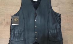 Canadian Made. Embossed Eagle on back and pockets. Size Tall Medium. AS NEW