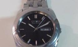 Stainless Steel Citizen Eco-Drive Watch, worn ~20 times. Works excellent, no batteries, no winding! Citizen quality with style!