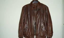 Large size brown bomber style with removable extra collar for colder conditions. Lined with Thermolite insulation. Made by Danier.