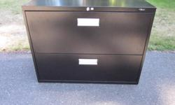 """Positive interlocking system prevents tipping Accommodates letter- and legal-size files Adjustable floor levelers and lock included Side-to-side file bars also included Made in Canada Steel, Black 27-1/8""""(H) x 36""""(W) x 18""""(D) 99 lb. Also each comes with"""