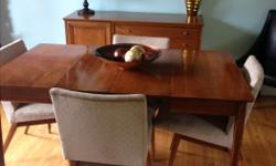 """Oak mid century table, chairs and buffet. Table measures 56"""" by 36"""" with two leafs and buffet is 50.5"""" wide, 18"""" deep and 32.5 high. The chairs need cleaning as they were in storage but the fabric has no tears or rips. Please email or text if interested"""