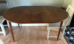 """Table is round without leaf or oval with the leaf in. Leaf is 19.5"""" wide and table is 41.5"""" in diameter. Table is 61"""" long with leaf in place. Needs a bit of love (legs and top need refinishing)."""