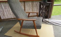 Mid Century teak rocking chair.