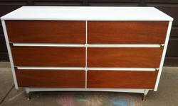 Mid century mahogany dresser lovingly, well, most of the time, updated to a sleek modern look. After stripping and sanding, the drawers were oiled with Tung oil, the body chaulk painted and sealed with semi gloss verathane. The original hardware has been