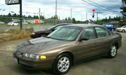 Make Oldsmobile Year 2002 Colour DEEP BRONZE METALLIC Trans Automatic kms 112000 *** ONLY ....112,000 KMS !!! Beautiful OLDS INTRIGUE SPORT SEDAN !!! *** You must see this absolutely MINT Oldsmobile , very LOW KMS on this spotless car . Has the nice 3.5