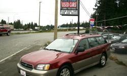 Make Subaru Colour GARNET RED METALLIC / LIGHT TAN Trans Automatic kms 95000 *** CREAM PUFF !! WOW !! LOW , LOW KMS !! >> 95,000 !! *** You must see this absolutely beautiful 2003 Subaru Outback AWD wagon , hard to find one this clean . This gem has the