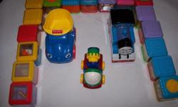 Train and 2 trucks and a bunch of blocks with small items in them. good condition as pictured Please click on VIEW SELLERS LIST above to see other items Ihave for sale 250 812 7765
