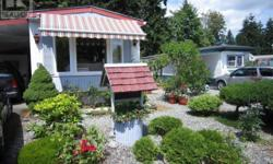 # Bath 2 Sq Ft 1100 MLS 411163 # Bed 3 This is an immaculate Mobil Home in Ladysmith BC which backs onto a green space with large evergreen trees, in a wonderful, quiet, friendly, 55+ park! 3 bedrooms, the Master with a walk in closet and 2 piece ensuite.