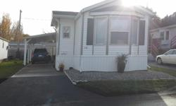 # Bath 2 # Bed 2 Move in ready, Never smoked and very clean. 7 yr old SRI mobile home in quiet well maintained, westsyde trailer park. Low taxes & pad rent. Open floor plan with 2 bedroom / 2 bath ( bd on each end). Open floor plan with Bay windows &