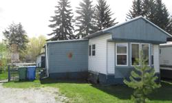 # Bath 1 Sq Ft 950 # Bed 2 Move-in ready! Leasehold #41 in KHMP, 1977 renovated trailer 14x64 plus addition and garden shed. New roof, siding, doors, windows, flooring, bathroom. Includes 4 appliances. Oil heating.
