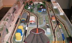 MODEL TRAIN LAYOUT - N Gauge - 6ft. x 3ft. Dual control, roundhouse, electric switches, buildings, landscaping, locomotives and cars. Easily stored. 250 762 6764