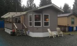 # Bath 1 Sq Ft 924 MLS 403898 # Bed 2 This almost new custom ordered modular home is located in a waterfront Mobile Home Park & has one of the nicest beaches on Cowichan Lake. Lush forests surround this very quiet & peaceful park. Meades Creek runs