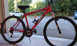 In almost new condition. Grip shift 21 speed mountain bike with front shocks. Terrific bike!