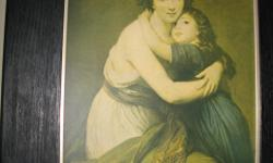 Early 1960,s picture of mother and child, in black barn wood frame, size 18 inches 24 inches.