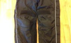 Women's Black Tour Master motorcycle overpant. Size Large 12 - 14 Like new. Worn twice