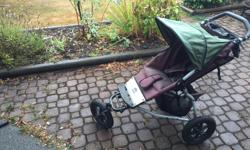 Mountain Buggy stroller with new seat and tires. Comes with rain shield, sun shade and handlebar cup holder/pouch.