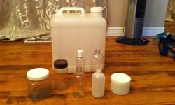 Multiple lotion/shampoo/salt scrub containers as well as ingredients. As well have several 500ml - 1L bottles of pure essential oils. Some 20 and 5ml EO brown glass containers with sealing lids/dropper. Some oils - palm, coconut, castor, jojoba. Wine