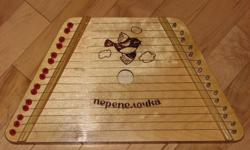 Music Maker brand lap harp for sale.  Easy and fun instrument can be played by anyone, no musical training or experience is required!  Sheet music slides under strings and the strings are plucked above each note to play the song.  Very fun and rewarding