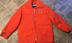"""This mustang floater coat is a size medium, designed for chest size 40"""" to 42"""". Two front pockets, hood with drawstring rolls up into the collar, tighten at the waist on the inside, sleeve cuffs adjust for a snug fit, zipper opens top down or bottom up."""