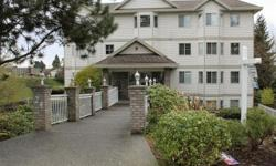"""# Bath 1 Sq Ft 640 MLS 413385 # Bed 1 Top Floor corner ocean view suite with warm southern exposure, and a beautiful sundeck, facing south and east, with views into Nanaimo Harbour. One block from Barsby Park & the very popular """"Seawall"""" leading downtown"""