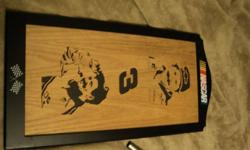 i have here a nascar lazer ingraved dale earnheart sign thats made out of wood it is brand new an very rare