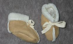 """Soles are about 4"""" long Suade like softness Made in Canada never worn 100% polyester Size - Large (or for 19 lb baby)"""