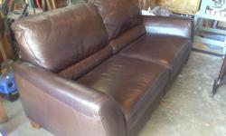 Brown soft leather sofa. All top stitched seams. Excellent condition New cost $3500