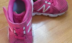 Pink running shoes by New Balance. Very light with good ventilation. In very good used condition. Size 8.5. See my other ads for more spring/summer footwear.