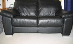 Year-old black leather couch and matching love seat purchased at Inspiration, Vancouver, for $2,000. Love seat sits 2. Couch seats 3. Leather in perfect condition, as new. Sad to have to sell these. Moving. $1,200 for pair. Prefer to sell as set, but will