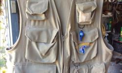 """brand new """"fishing hole"""" fly fishing vest, never used, received as a gift several years ago. Retails new over $65. Size large."""