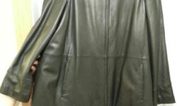 NEW Large Women's Danier genuine leather coat ( $499 original price) Black, genuine leather. Very comfortable. It was never worn. Has tags attached. Call 250 2182244 Thanks for watching.
