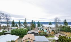 # Bath 2 Sq Ft 2220 MLS 403053 # Bed 4 Ocean view, character home, 2200 sq ft, 4 bed, 2 bath with lane access to 20x31 sq ft detached shop. Coved ceilings and original refurbished hardwood floors upstairs. The views can be enjoyed from both floors. Recent