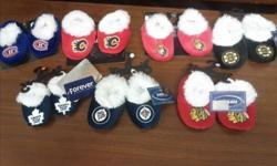 We have a large collection of NHL branded baby slippers that retailed for $12.99 each. The teams consist of Chicago Blackhawks Winnipeg Jets Ottawa Senators Edmonton Oilers Calgary Flames Toronto Maple Leafs Boston Bruins Supplies are limited, please act