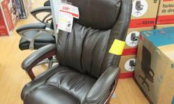 Dark brown leather office chair by Westcliffe from Staples.New still in box.Bargain at $160