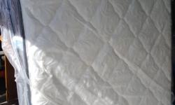 Brand New Simmons Double Mattress for Sale Westminster Alton Model Tight Top Firm Surface Gel Technology? Foam keeps you cool and comfortable all night long Titanium Lumbar Support Pocket Coil Technology 2 Available Call 250 714-3890