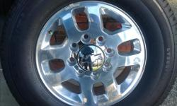 """For sale, New take off 18"""" aluminum wheels and 10 ply Michelin LTX A/T2 tires off of a 2015 Chevrolet Silverado 3500. Will fit 2500 as well. Less than 10 kilometres on them, mint condition. If you've got a gmc, your gmc centre caps will transfer over to"""