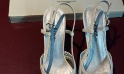 New , still in the box , never worn , white Jessica , Varsity high heels , size 5-M