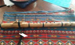 This is a brand new Native American flute from Woodsounds - one of the top makers in the world. It is in the key of E and made from beech wood. In addition to the flute, we will also include: - a fleece bag - a flute lesson to get you started - some