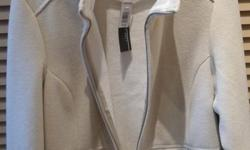 This Beige Sweater/Jacket is Brand New with the tags and has Never been worn. The brand is LADY HATHAWAY and is a size XL. It is a zipper up style, with two outer zipper up pockets. The inside lining is SO SOFT. It is like a fine Chenille. Contact me if