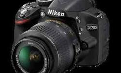 Nikon D3200 DSLR with 18-55mm lens along with memory card, case and tripod