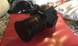 Nikon D5100 and 18-200VR Lens for sale. Has been a great combo but am looking for something a bit faster for sports shooting. Protective filter on the lens since new. Comes with camera, lens, battery and charger.