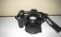 Nikon Coolpix 5700 digital camera. 5 megapixel, 8x zoom, 2 rechargable batteries, battery charger, strap, software, 3 compact flash memory cards. Also a Lowepro case. Excellent condition.