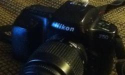 This nikon F50 is a 35mm film camera. Features autofocus, TTL light metering an various other programs. Also comes with a tripod stand, removable flash, and multiple lenses all in a convenient carrying case. This ad was posted with the Kijiji Classifieds